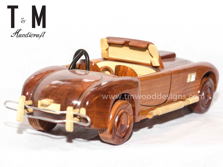 Design of car model - 1965 Shelby Cobra Handcrafted Mahogany Wooden Model Car Wood Art