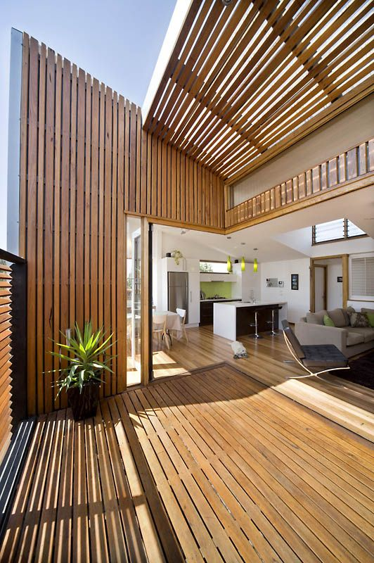 The Raking Roof Creates Volume To Make The Space Feel Bigger Than Its Modest Footprint House Exterior Cladding House Cladding Container House