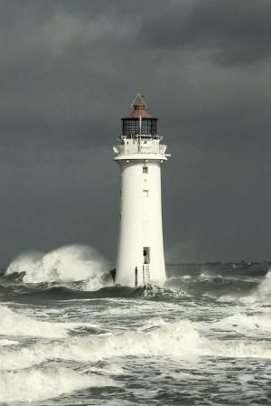 Lighthouse in an Irish Sea Storm by David Firth by margo
