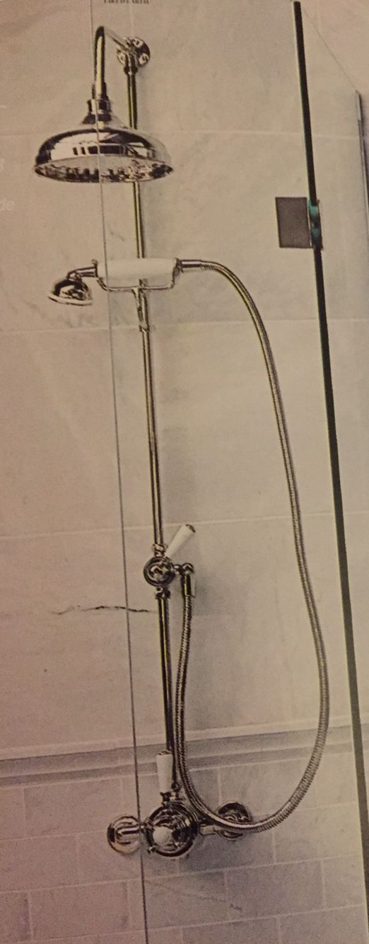 Traditional fixed shower head with hand held attachment. | Board of ...