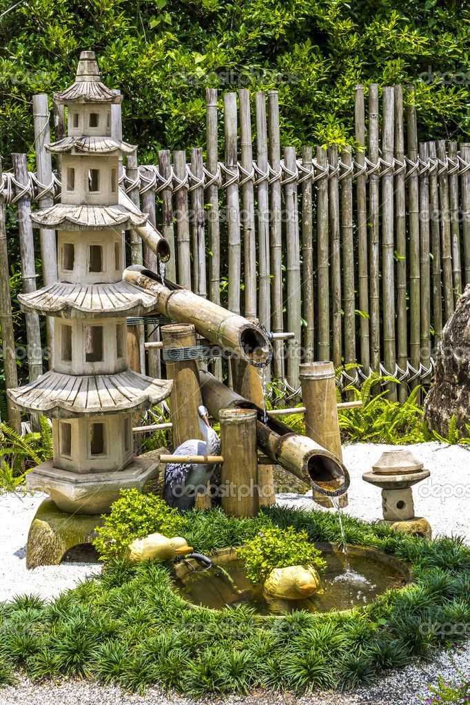 pagada stone and bamboo fountain in japanese garden stock photo