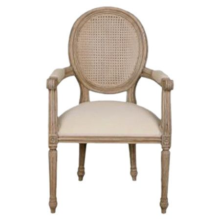Showcasing a woven rattan back and an upholstered seat, this elegant arm chair transforms your parlor or sunroom with its effortlessly classic design.