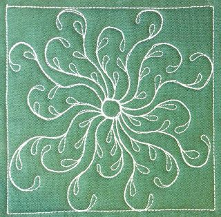 Sea Oat Flower is a really easy free motion design. Start with your circle and radiate out with a set of Sea Oat petals working in one direction. Watch the video and learn to sew this at http://freemotionquilting.blogspot.com/2011/03/day-266-sea-oat-flower.html