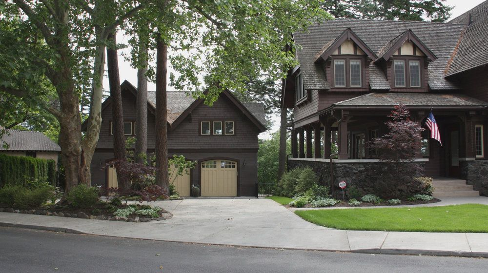 Craftsman house with large porch and detached garage