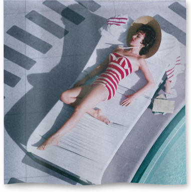 Austrian actress Mara Lane lounging by the pool in a red and white striped bathing costume at the Sands Hotel, Las Vegas, 1954