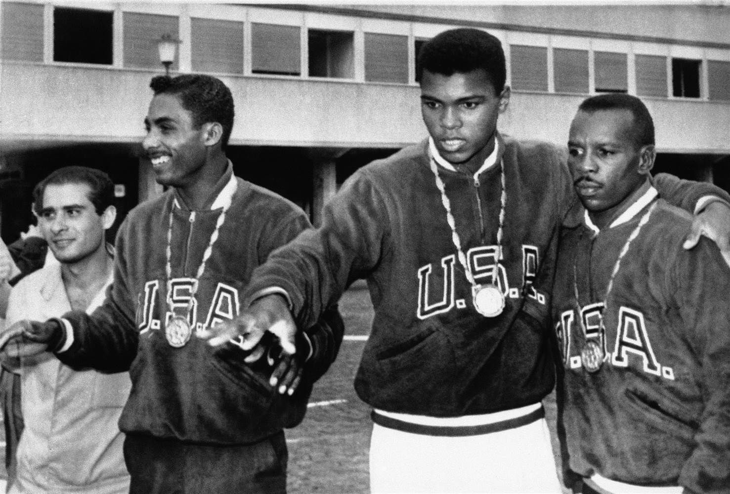 A trio of U.S. boxers wear gold medals at the Olympic