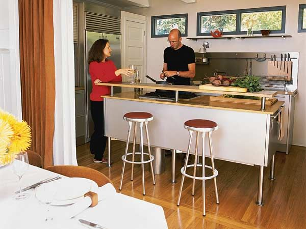 This Stainless Steel Kitchen Can Be Hidden From The Dining Room By Curtains