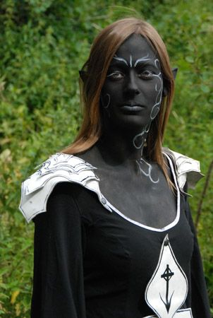 dark elven queen - very few people have done dark elven makeup well. I like the way this was done. I think it would look absolutely perfect with a deep deep purple color in the dress somehow and her hair white with red contacts in her eyes