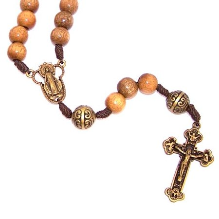 A Wooden Rosary With A Bronze Tone Center And A Special Crucifix