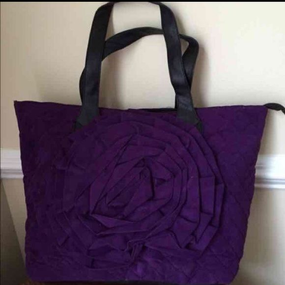 Large Purple Quilted Tote NWOT Quilted with faux leather trim.  Large size. Zip top with lots of inside pockets. Bags Totes