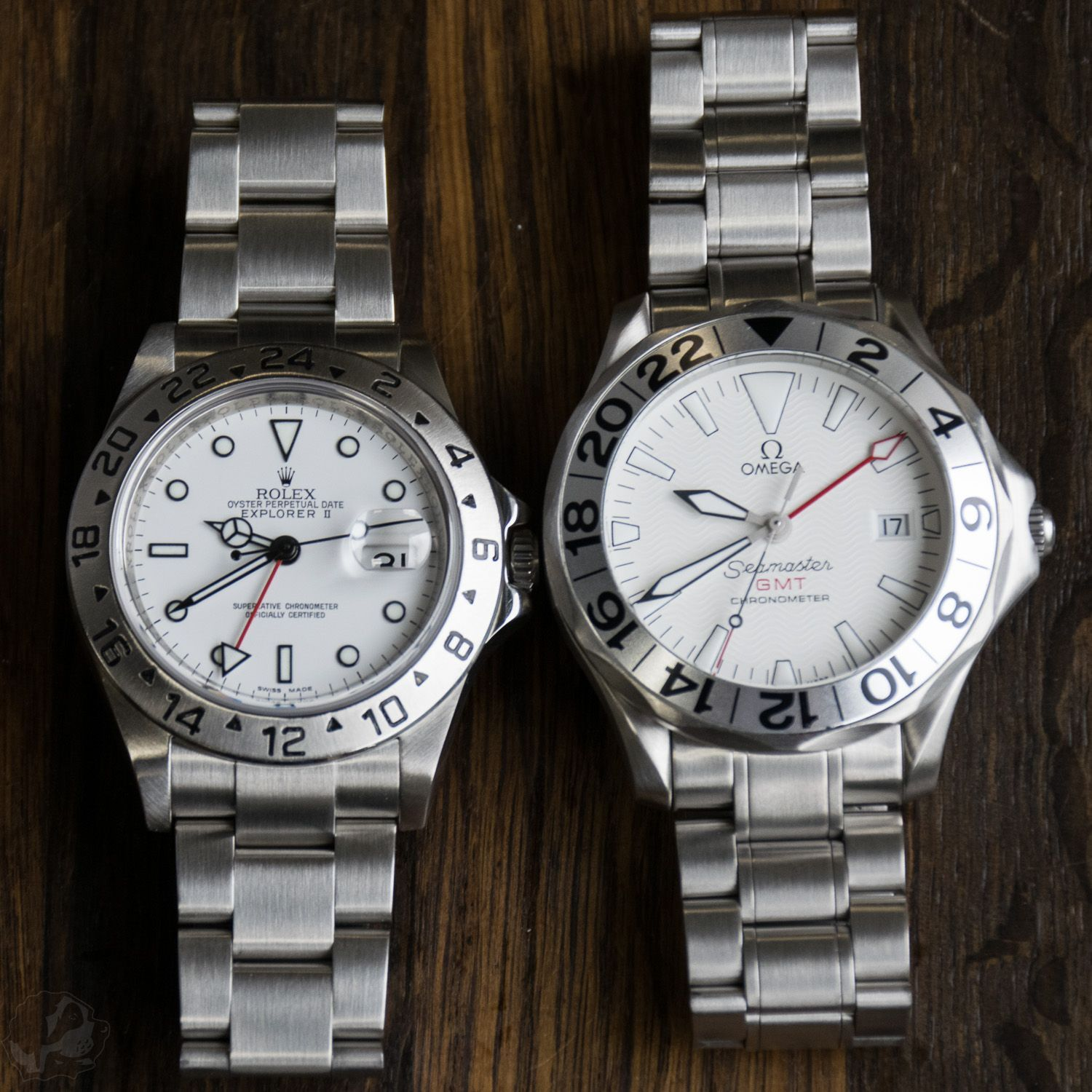 A pair of Polar GMT watches: Rolex Explorer II 16570 vs Omega Seamaster GMT Great White. #Omegaseamaster #rolexexplorer