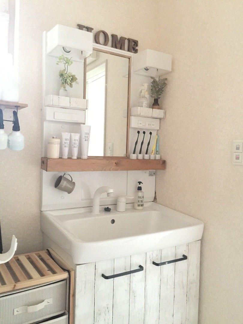 100均リメイクシートと木で洗面台をナチュラルに 洗面所