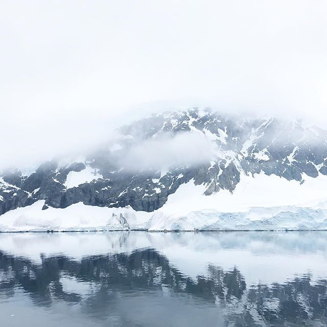 when were not fraternizing with penguins most of our time has been spent just looking out onto the amazing landscape of the continent. when were lucky the water looks like a mirror