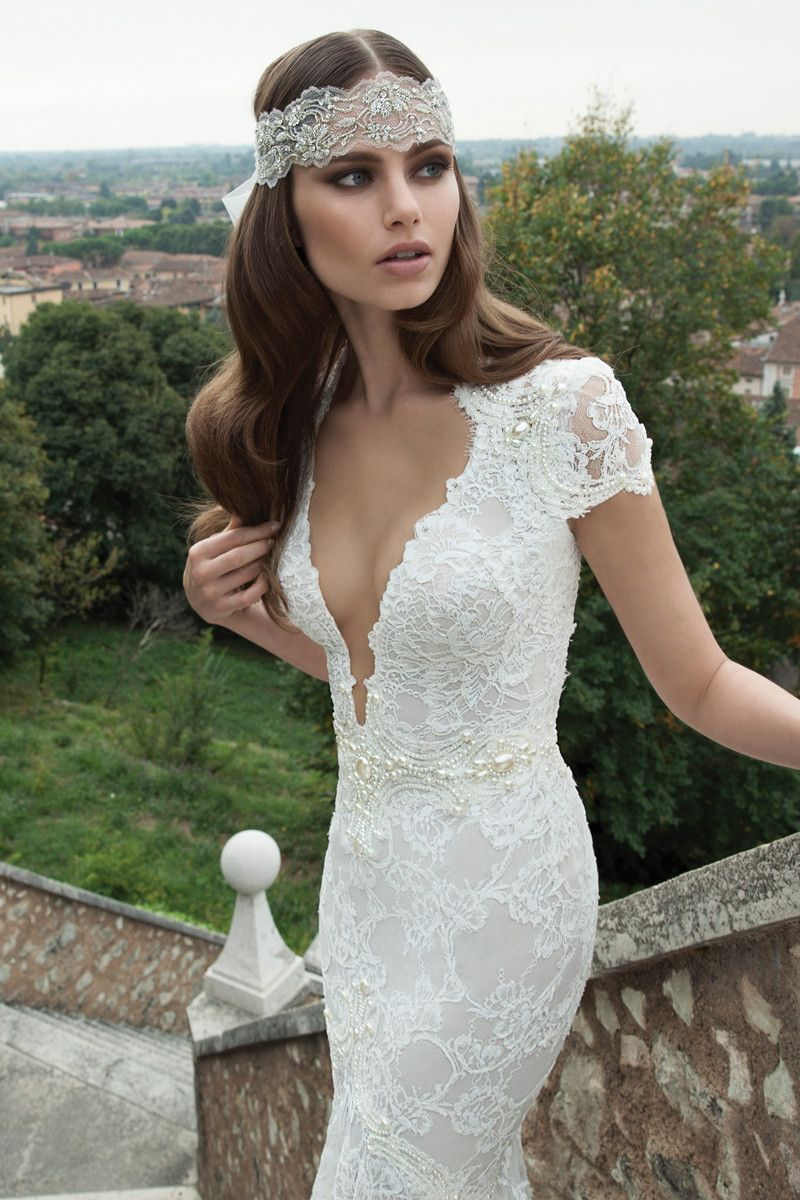 Hello, Gorgeous! Can't decide what our favorite part of this picture is - the dress or the headpiece!? {Berta Bridal}