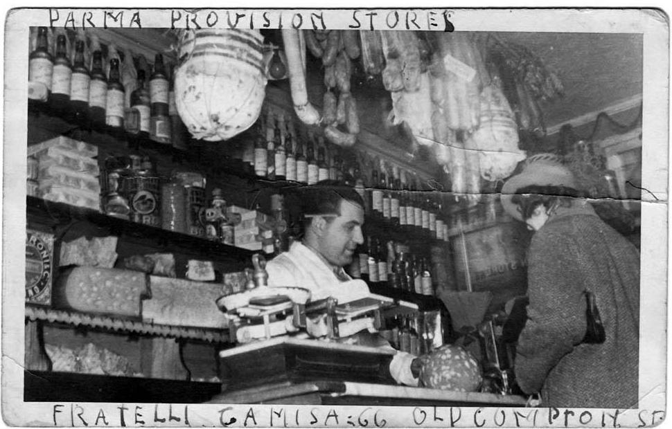 Izodoro Camisa serving in the shop
