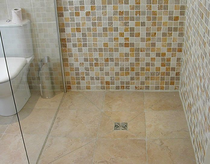 Small bathroom design wet room wet room sloped floor for Small room flooring ideas