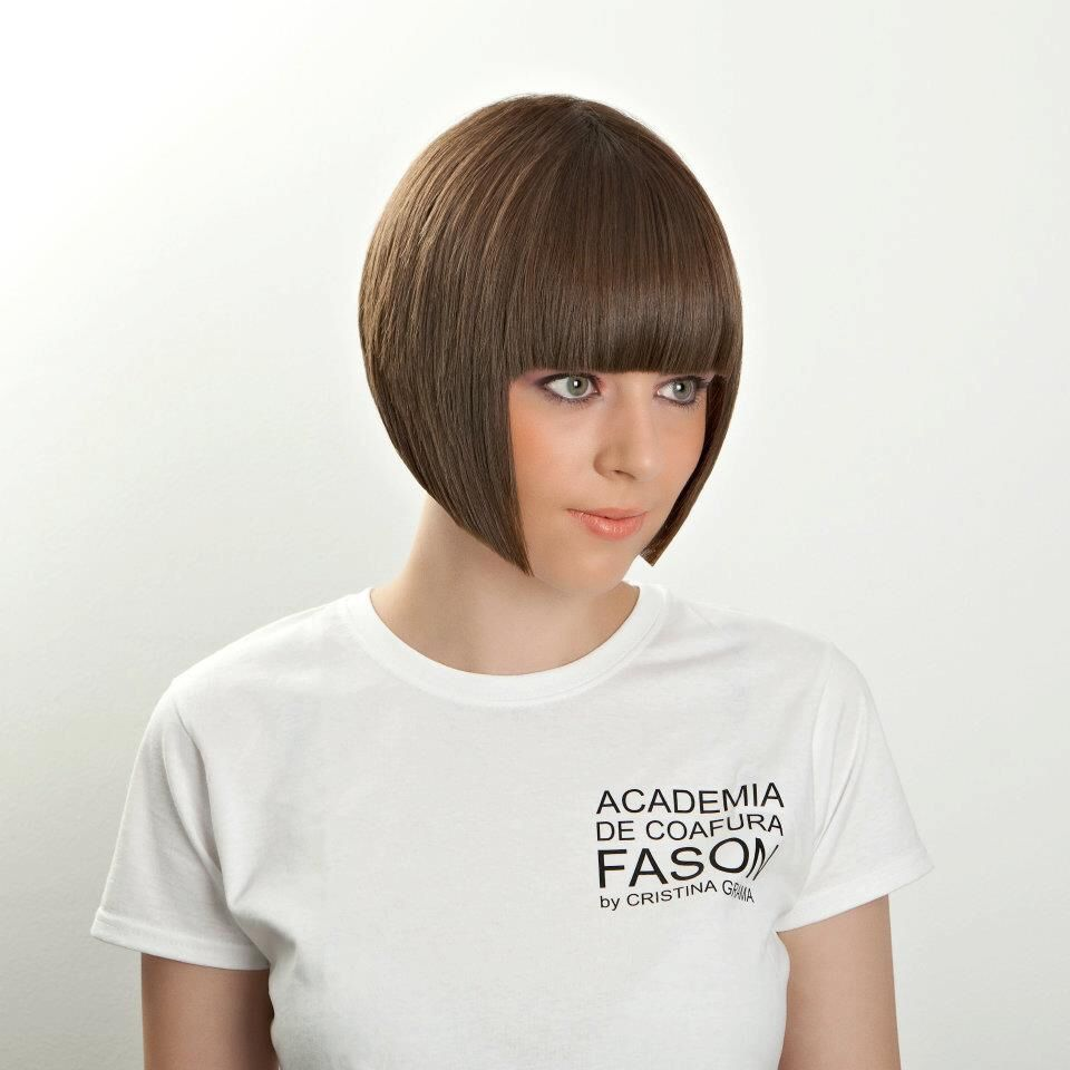Rounded bob with precision fringe.