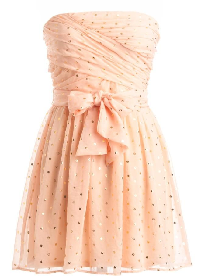 Swathed Sprinkles Dress: Features a chic strapless cut with a beautiful swathed bodice, gorgeous peach mesh overlay with tonal liner for full coverage, matching ribbon sash at waist, and apple-shaped sprinkles peppered throughout to finish.