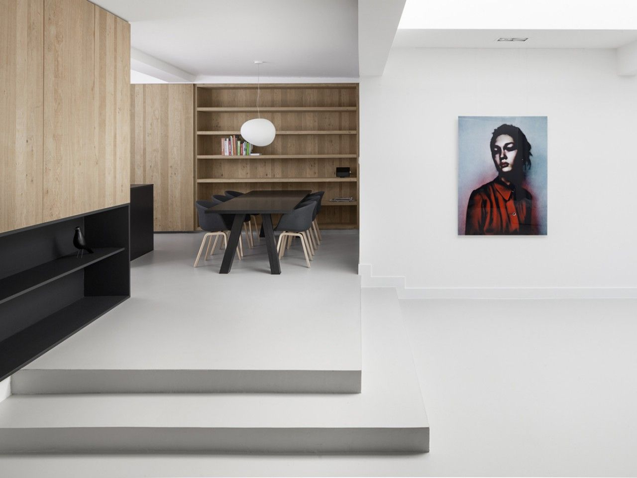 Dezeen magazine dutch studio converts amsterdam garage into a single storey two bedroom apartment home 11 matte black furniture stark white walls