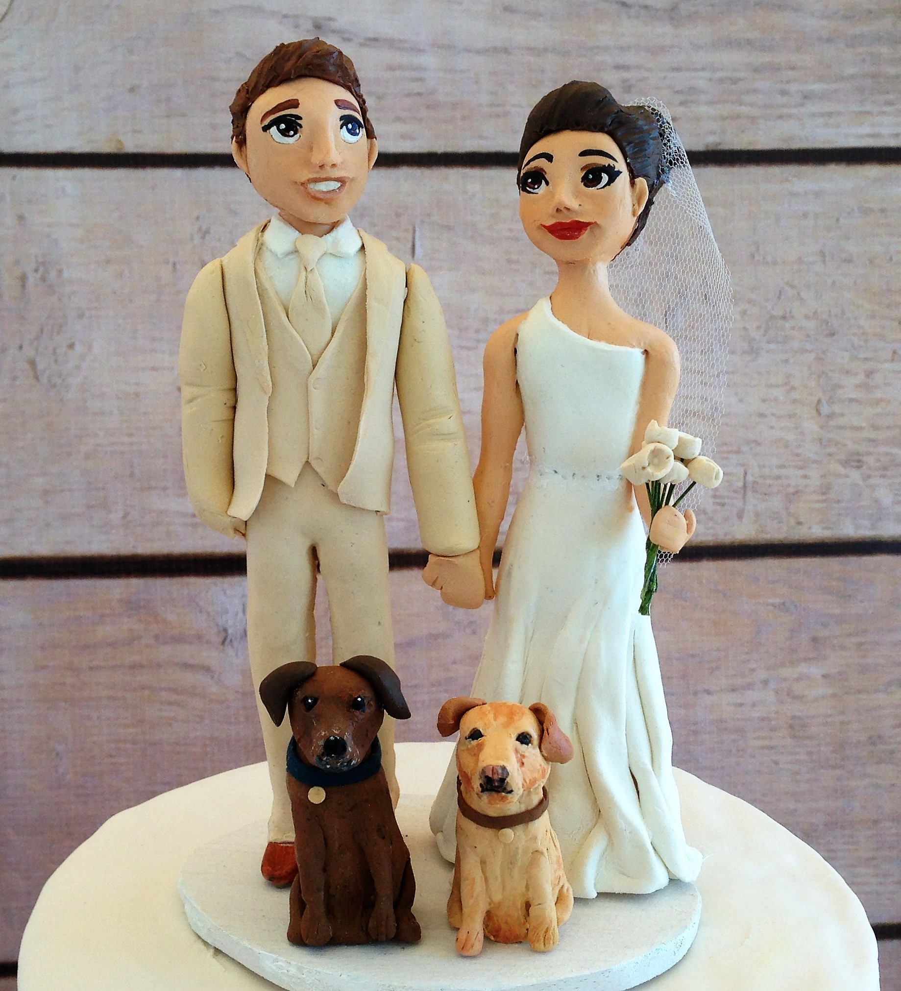 Clay figurine wedding cake topper with dogs wedding cake