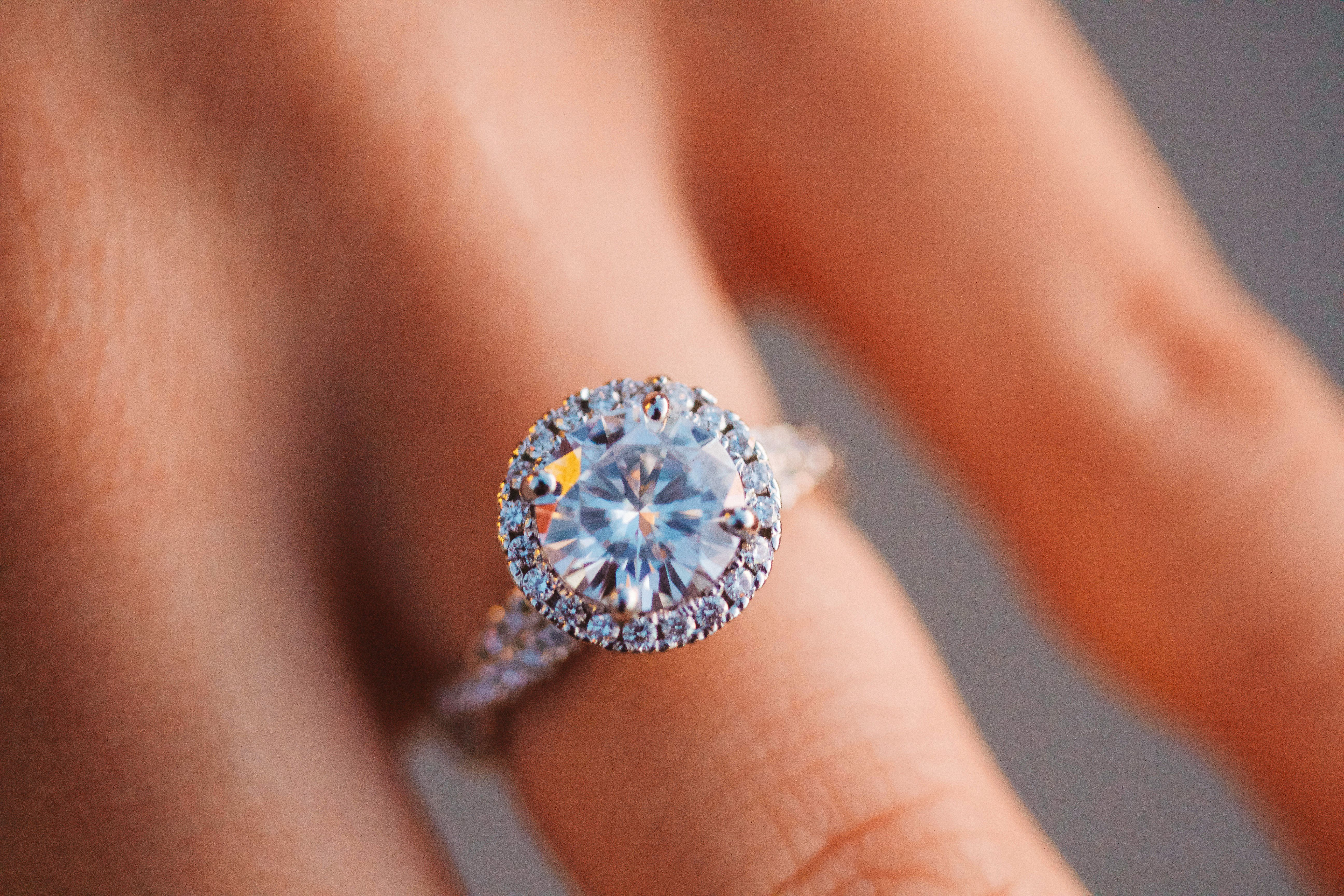 1.5 ct. moissanite halo ring with twist band.
