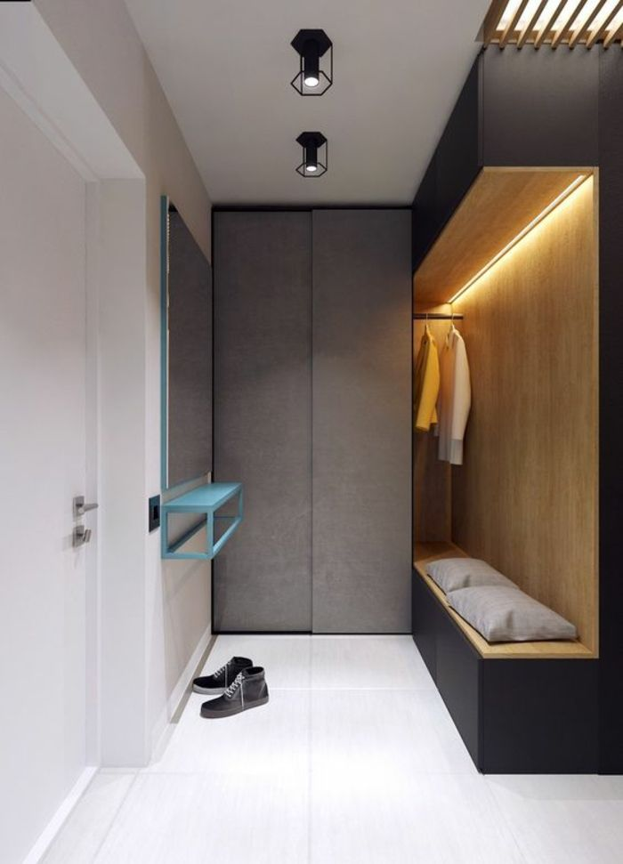 idee deco hall d entree maison avec des meubles aux formes geometriques coussins gris clair sur le banc