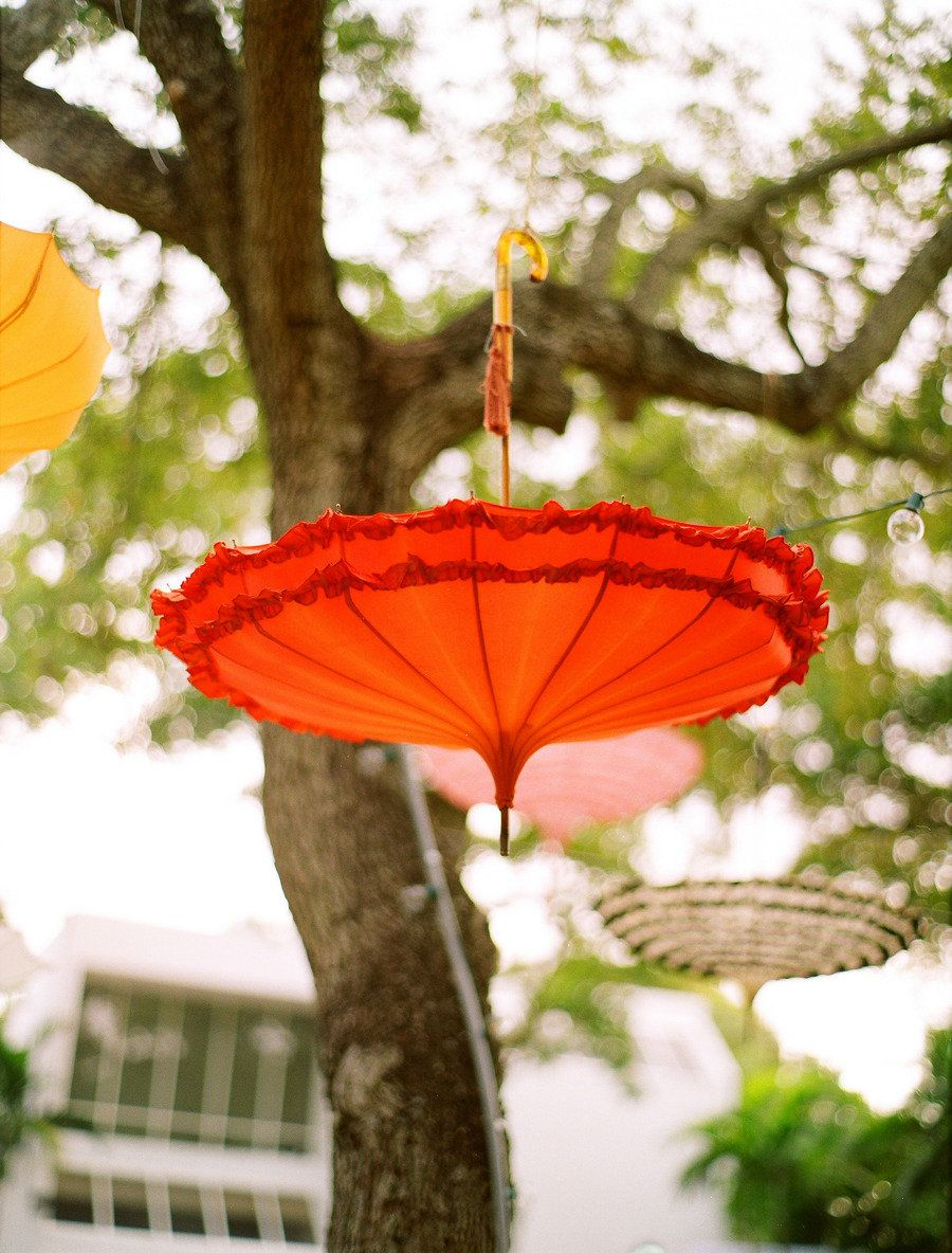 upside-down umbrellas in the trees - via style me pretty