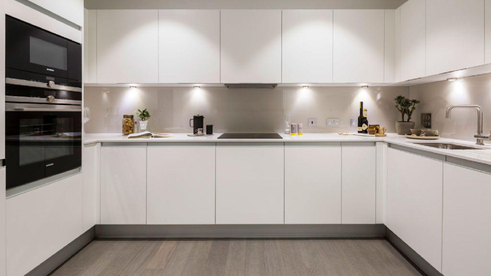 Porcelanosa Grupo Projects Apartamentos Minimalistas En El Centro De Londres Modern Kitchen Kitchen Kitchen Cabinets
