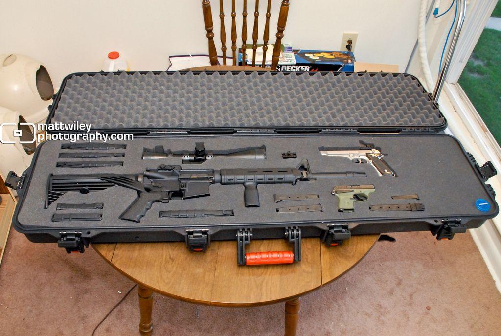 guitar case holds many guns cool i want it guns hand guns gun cases. Black Bedroom Furniture Sets. Home Design Ideas