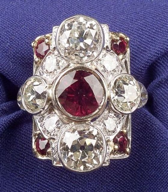 Art Deco Platinum, Ruby, and Diamond Ring, bezel-set with a circular-cut ruby and four old European-cut diamonds, four diamond and four ruby melee accents, approx. total diamond wt. 3.90 cts.