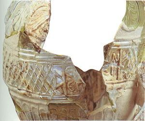 """Roman glass jug signed by Ennion, 1-50 A.D. Blown in a four part mold, inscribed E N N I O N E P O I E I """"Ennion Made Me"""". Slomo Moussaief collection"""