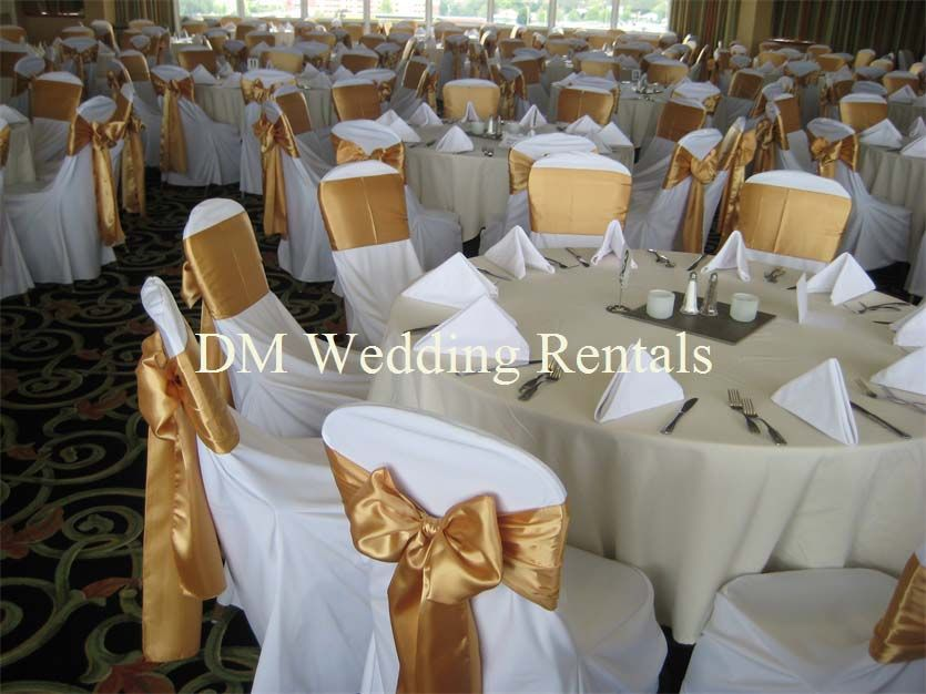White Chair Covers With Gold Satin Sashes Wedding Decor