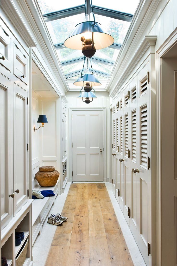 Hallway closet door  elegant mudroom with glass ceiling bench  bespoke cabinetry