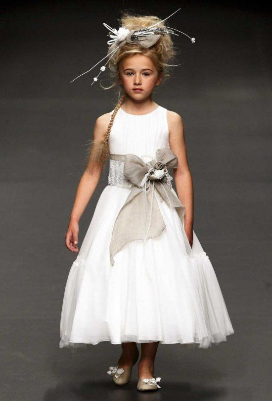 7e36146f9dd A young model presents a First Communion dress by Spanish designer  Hortensia Maeso during the Cibeles Madrid Novias fashion week in Madrid