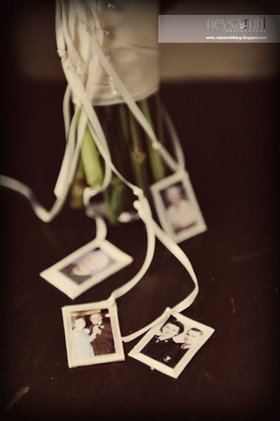 A lovely way to include those watching over us - the bridal bouquet had tiny photos of family members hanging from ribbons. Beautiful idea.