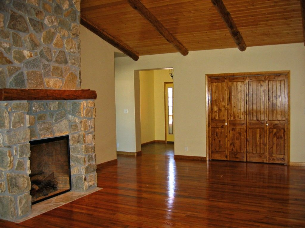 Hardwood flooring and knotty pine ceiling