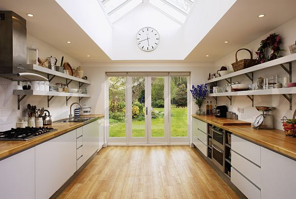 Wooden Flooring And Glass Patio Doors In Modern Kitchen Extension With  Fitted White Units   EWA
