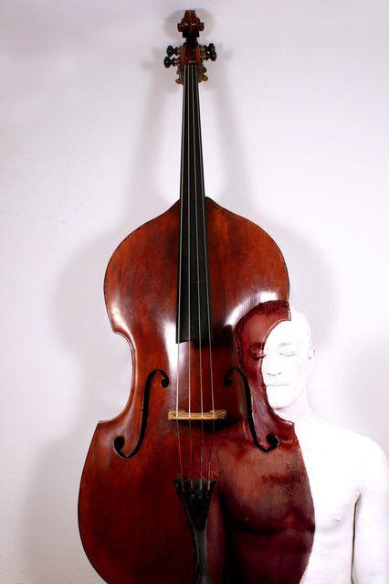 """Double Bass"". (Photo by Johannes Stötter) http://avaxnews.net/wow/Impressive_Bodypainting_by_Johannes_Stotter.html"