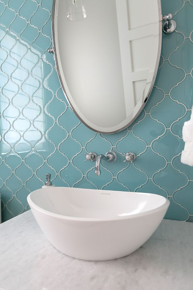Blue glass tiles add dimension and a timeless appeal to this powder ...