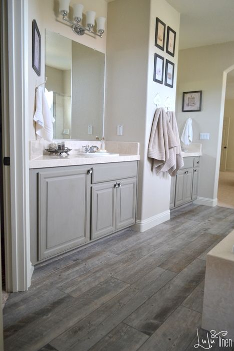 Carpet in a bathroom. Seriously, who came up with that? It is just. Gray Tile  FloorsPorcelain Tile FlooringWood ... - 20 Amazing Bathrooms With Wood-Like Tile Rustic Vanity, White