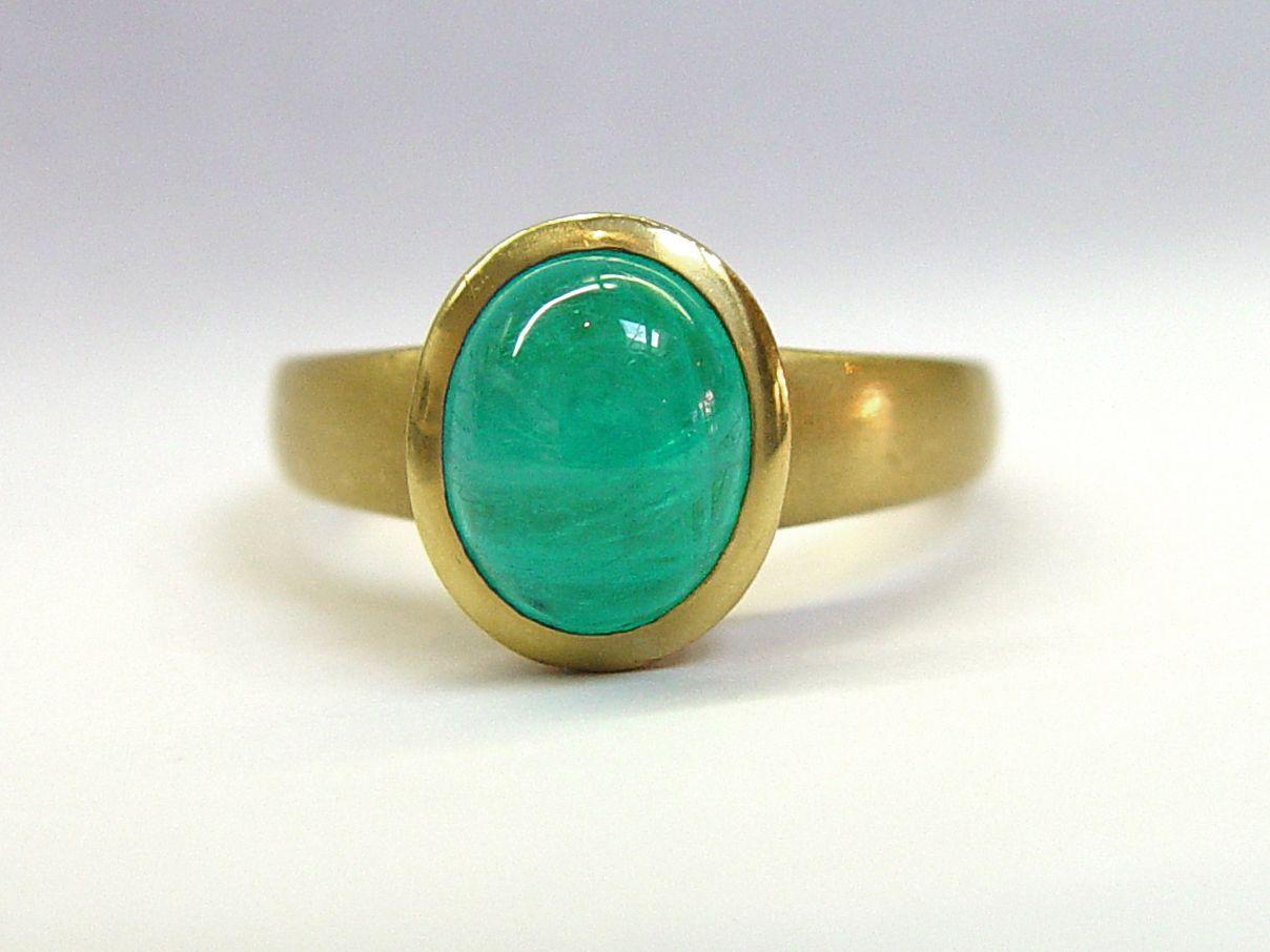 Paraiba Tourmaline in 22kt gold bezel ring.  Handmade at Union Street Goldsmith, San Francisco.