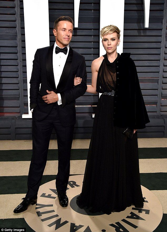 Two's company: Scarlett was joined on the red carpet by talent agent Joe Machota...