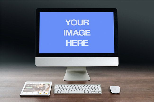 Imac computer monitor display mockup mediamodifier technology a professional apple imac computer on a wood desk background online mockup template of a monitor with front view ipad a keyboard next to it pronofoot35fo Gallery