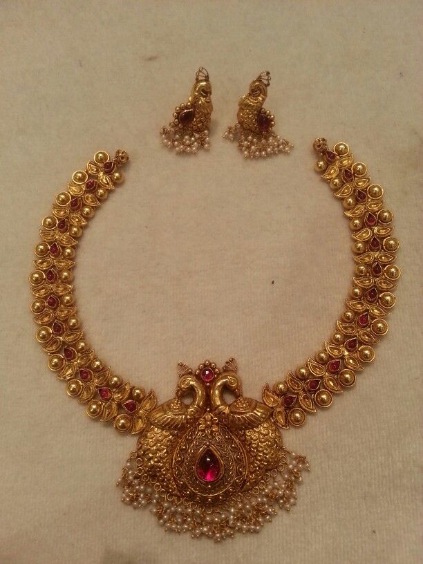 Stand Out Designs Jewelry : Antique gold necklace and earrings with peacock design