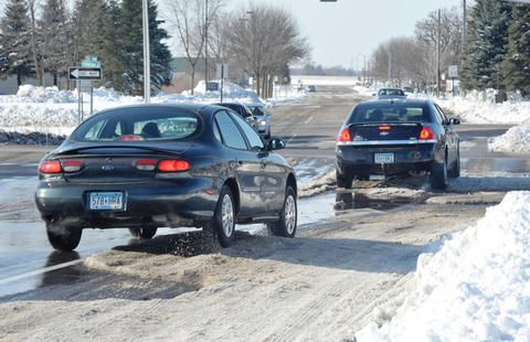 cool Lingering ice ruts from blizzard make for bumpy ride in central MN