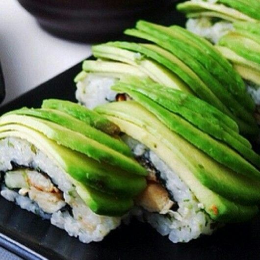 Fresh sushi topped with avocado