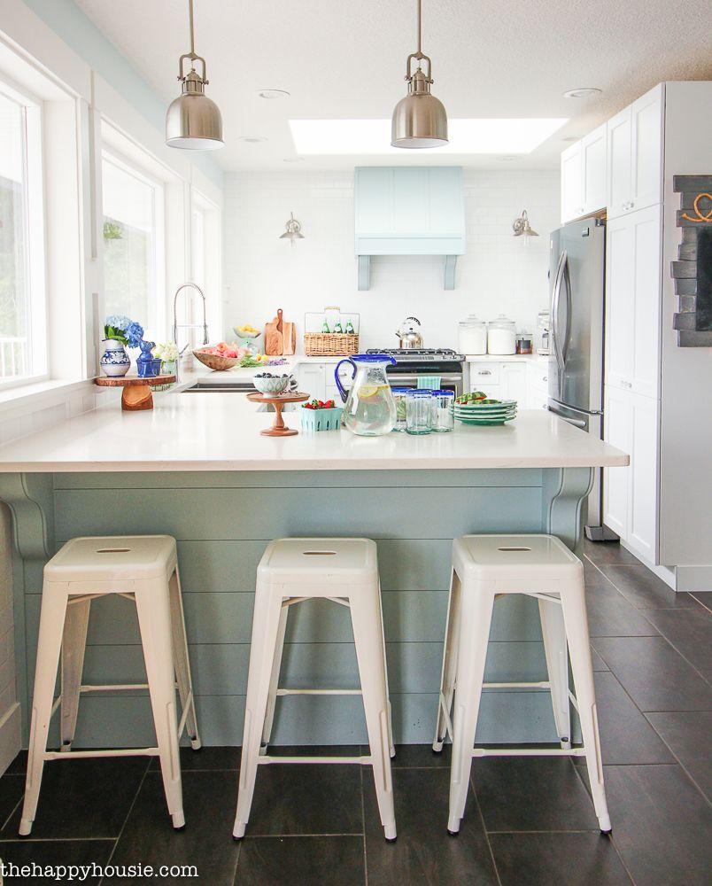 a cozy coastal cottage kitchen with classic white metal bar stools rh pinterest com au