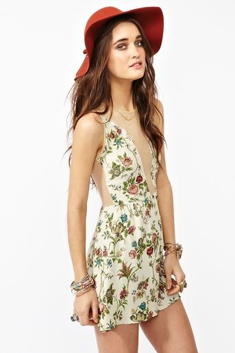 Beauty, love the mesh panel, from NastyGal  http://www.nastygal.com/clothes/lulu-dress-floral