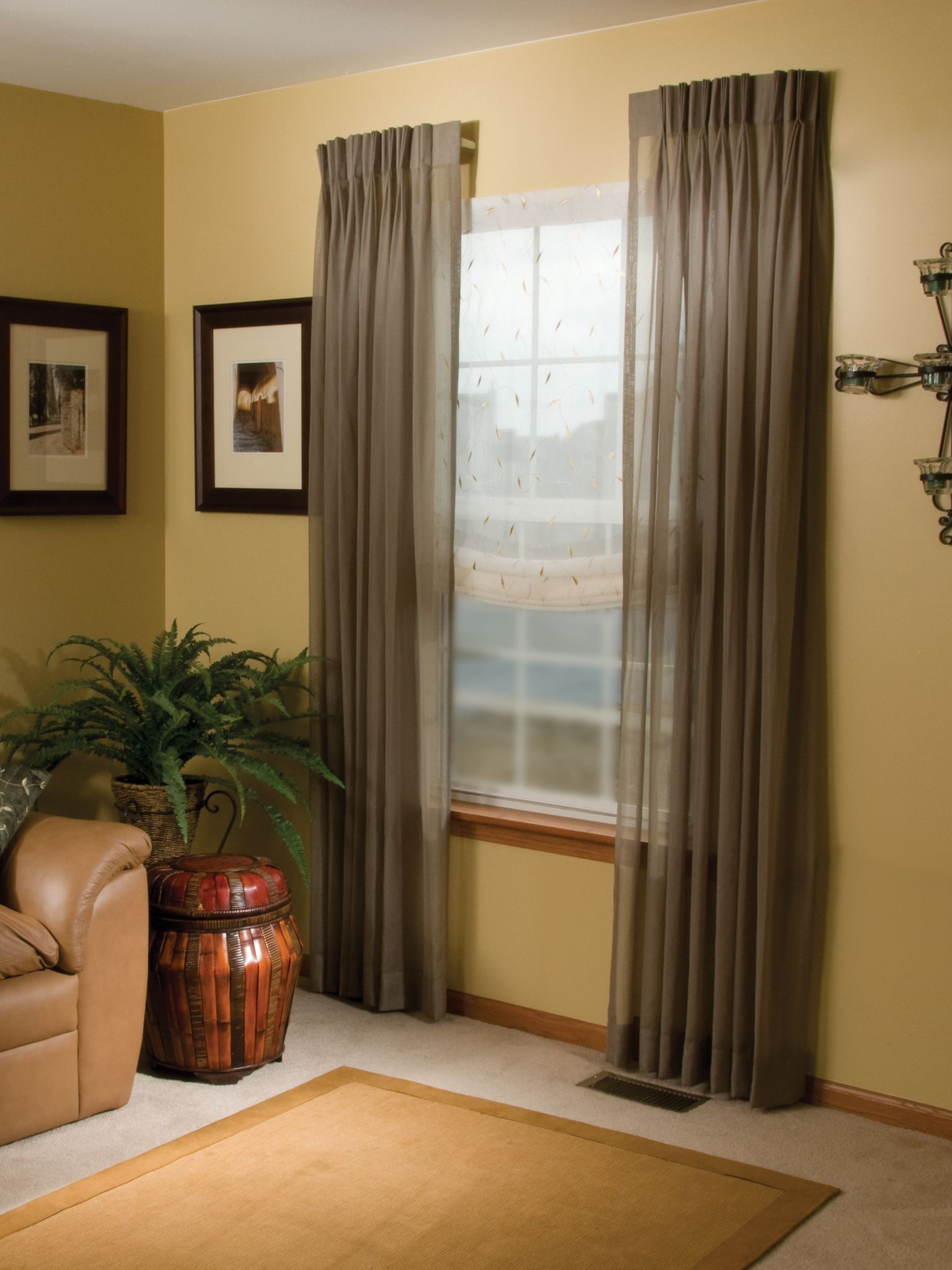 decorative side panels with short rods on arched window | drapery