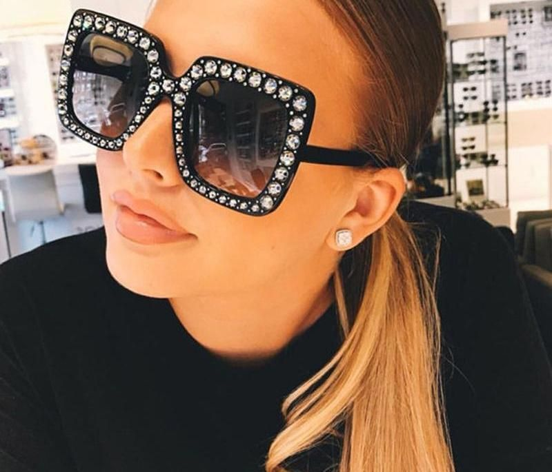 Blinged out BooGee Sunglasses.